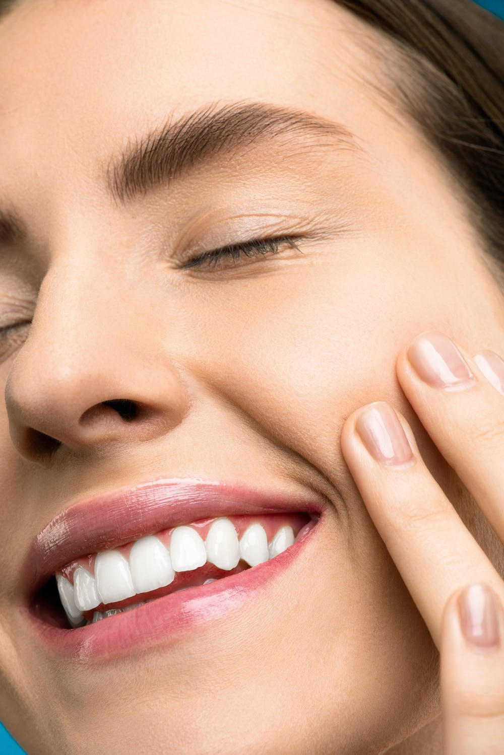 Advanced Dental Wellness of Ft lauderdale -Smiling tooth pain pic